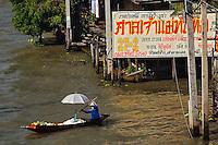 Thai woman on way to Damnoen Saduak Floating Market, Damnoen Saduak, Thailand