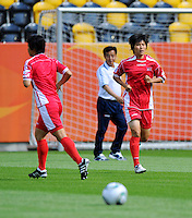 Yun Mi Jo (r), player of North Korea, during a training session at the FIFA Women's World Cup at the FIFA Stadium in Dresden, Germany on June 27th, 2011.