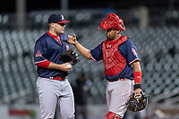 Memphis Redbirds relief pitcher Ryan Meisinger (23) and catcher Francisco Pena (28) during a Pacific Coast League game against the Omaha Storm Chasers on April 26, 2019 at Werner Park in Omaha, Nebraska. Memphis defeated Omaha 7-3. (Zachary Lucy/Four Seam Images)