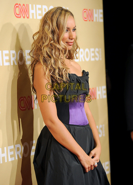 LEONA LEWIS .at The 3rd Annual CNN Heroes: An All-Star Tribute held at The Kodak Theatre in Hollywood, California, USA,  November 21st 2009                                                                   .half length black and purple waistband dress strapless side profile .CAP/RKE/DVS.©DVS/RockinExposures/Capital Pictures