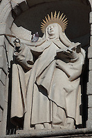 Detail of Statue of St Teresa, main facade, Convento de Santa Teresa,(Convent of St Teresa), 1629-36, Avila, Spain, built in Baroque style on the site of St Teresa's birthplace by architect and monk Alonso de san Jose (1600-54). Santa Teresa (1515-82), was a Carmelite nun, canonized 1622. Photograph by Manuel Cohen.