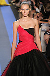 Anya walks runway in a magenta faille strapless draped carbon tulle ball gown, by Monique Lhuillier, from the Monique Lhuillier Spring 2012 collection fashion show, during Mercedes-Benz Fashion Week Spring 2012.