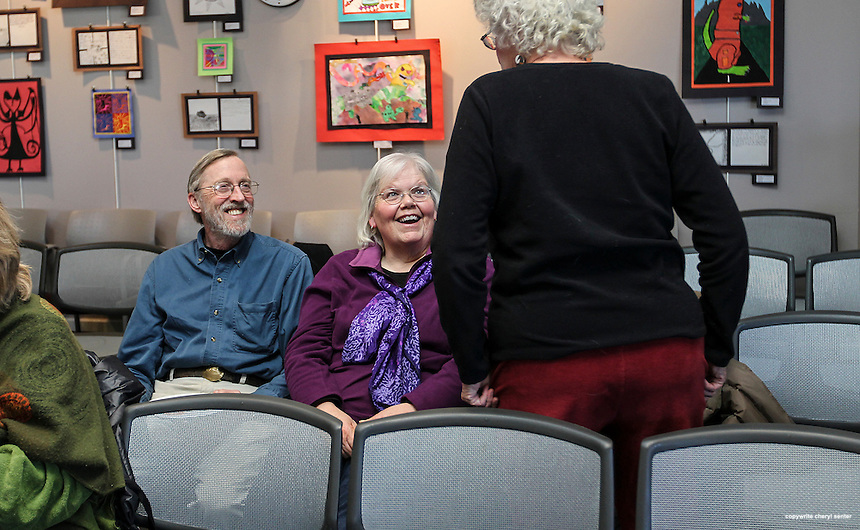 Portsmouth, N.H., Sunday, March 9, 2014: Northwood residents from left, Ted Wilkinson, Meg McGoldrick and Lucy Edwards talk while waiting to hear DC correspondent for The Nation magazine, John Nichols speak at the Portsmouth Public Library.  Portsmouth Herald Photo Cheryl Senter