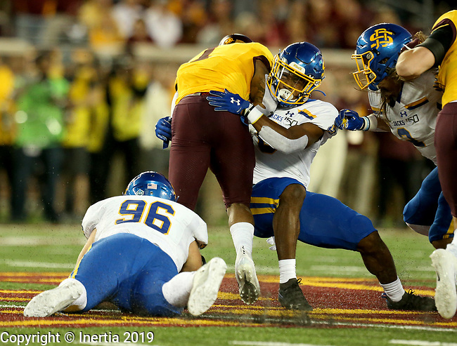 MINNEAPOLIS, MN - AUGUST 29: Michael Griffin II #6 from South Dakota State University brings down Rodney Smith #1 from the University of Minnesota during their game Thursday night at TCF Bank Stadium in Minneapolis, MN. (Photo by Dave Eggen/Inertia)