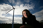 Former Wall Street lawyer Colleen Brown recently made the sustainable career transition to work at Aeolis Wind Power Corporation in Sidney, British Columbia. Here she poses for a photograph next to a model wind turbine as there are currently no wind farms in operation in British Columbia yet. Photo assignment for the Globe and Mail national newspaper in Canada.