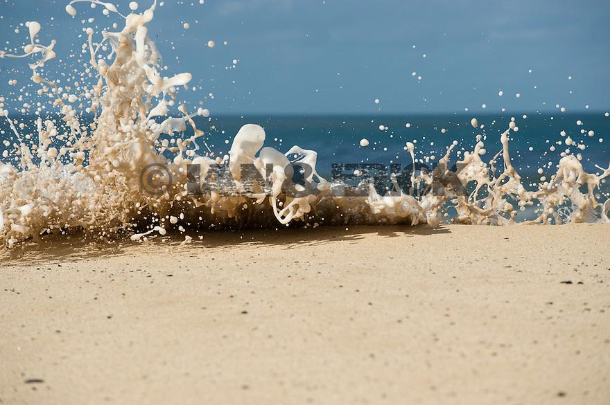 White water foam hitting the beach at Waimea Bay in Hawaii.