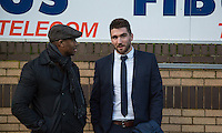 Matt Ingram of QPR watches his old team with former Wycombe player Leon Johnson during the Sky Bet League 2 match between Wycombe Wanderers and Leyton Orient at Adams Park, High Wycombe, England on 23 January 2016. Photo by Andy Rowland / PRiME Media Images.