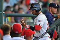 Second baseman Yoan Moncada (24) of the Greenville Drive in a game against the Augusta GreenJackets on Thursday, July 16, 2015, at Fluor Field at the West End in Greenville, South Carolina. The Cuban-born 19-year-old Red Sox signee has been ranked the No. 1 international prospect in baseball by Baseball America. Greenville won, 11-5. (Tom Priddy/Four Seam Images)