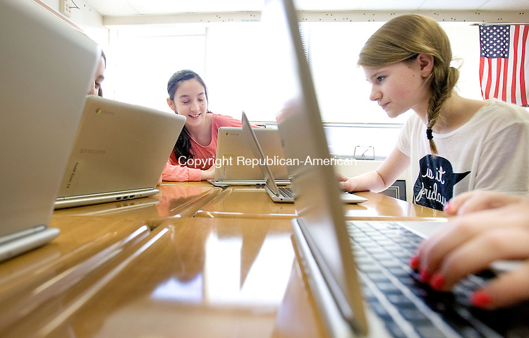 CHESHIRE CT. 15 December 2013-121613SV07-From left, Maddie O&rsquo;Connor, 13, of Cheshire and Emily Russolillo, 12, of Cheshire work on their Crombook computers at Dodd Middle School in Cheshire Monday. A new grant is being used to buy Chromebook computers for every student at the school. <br /> Steven Valenti Republican-American