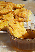Montenegrin food speciality: fried bread that you dip in honey, a bowl of honey Durovic Jovo Winery, Dupilo village, wine region south of Podgorica. Vukovici Durovic Jovo Winery near Dupilo. Montenegro, Balkan, Europe.