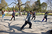 Tai chi with swords in park of the Temple of Heaven, Beijing, China