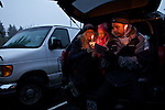 03/21/12--Jay and Ally Scroggin with their daughter, Brooke, take shelter from the falling snow in the back of the car during a candlelight vigil Lenten service in the parking lot at Living Savior Lutheran Church..Photo by Jaime Valdez.................................