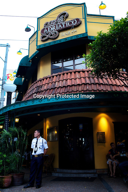 A guard stands against the facade of the Adriatico Cafe in Malate, Manila in the Philippines. Photo: Sanjit Das