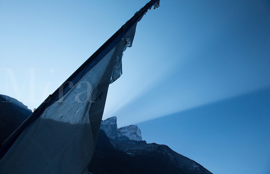 Nepal A prayer flag standing still in the early morning Shot in the village of Orsho. remote, Mt Everest, Himalayas