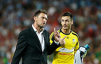 Wanderers coach Tony Popovic (L) talks to Sydney FC goalkeeper Vedran Janjetovic after their A-League match in Sydney, March 8, 2014. VIEWPRESS/Daniel Munoz EDITORIAL USE ONLY