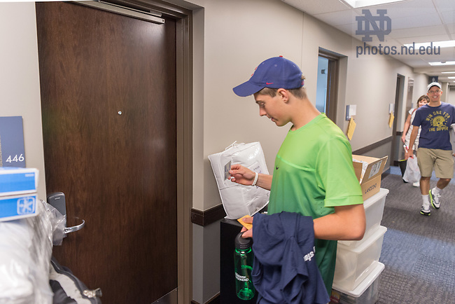 August 19, 2016; First year student Patrick Quinn from Portland, OR prepares to enter his Dunne Hall dorm room for the first time on move-in day of Welcome Weekend 2016. (Photo by Matt Cashore/University of Notre Dame)