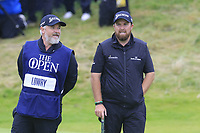Shane Lowry (IRL) and caddy Bo walk on the 18th green with a 6 shot lead during Sunday's Final Round of the 148th Open Championship, Royal Portrush Golf Club, Portrush, County Antrim, Northern Ireland. 21/07/2019.<br /> Picture Eoin Clarke / Golffile.ie<br /> <br /> All photo usage must carry mandatory copyright credit (© Golffile | Eoin Clarke)