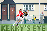 Cian Horan East Kerry tackles Shane O'Callaghan Austin Stacks  during their SFCC clash in Lewis Road on Saturday