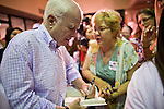 Aug. 23, PHOENIX, AZ: US Sen. JOHN McCAIN autographs a copy of his book for a supporter at an election rally in his campaign offices in Phoenix, AZ, Monday. US Sen. John McCain held the final of his primary election campaign at his campaign offices in Phoenix Monday. McCain, Arizona's senior Republican US Senator, is facing former Congressman JD Hayworth in the primary, Tuesday, Aug. 24. McCain has outspent Hayworth by a considerable margin and is expected to win.   Photo by Jack Kurtz
