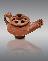 Bronze Age Anatolian terra cotta three spouted teapot - 19th to 17th century BC - Kültepe Kanesh - Museum of Anatolian Civilisations, Ankara, Turkey. Against a grey background.