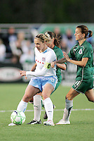 Lindsay Tarpley #5 under pressure from Athletica defenders..Saint Louis Athletica were defeated 1-0 by Chicago Red Star.