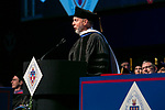 Craig W. Hartman, world-renowned architect, addresses the graduating class after receiving his honorary degree Sunday, June 11, 2017, during the DePaul University College of Science and Health and College of Liberal Arts and Social Sciences commencement ceremony at the Allstate Arena in Rosemont, IL. (DePaul University/Jamie Moncrief)