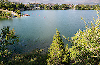 Quarry Lake located in north Austin is the showpiece of beauty and a serene lake spot for fishing, SUP, canoeing and kayaking, and other small watercraft.