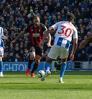 Bournemouth's Steve Cook (left) under pressure from Brighton & Hove Albion's Bernardo (right) <br /> <br /> Photographer David Horton/CameraSport<br /> <br /> The Premier League - Brighton and Hove Albion v Bournemouth - Saturday 13th April 2019 - The Amex Stadium - Brighton<br /> <br /> World Copyright © 2019 CameraSport. All rights reserved. 43 Linden Ave. Countesthorpe. Leicester. England. LE8 5PG - Tel: +44 (0) 116 277 4147 - admin@camerasport.com - www.camerasport.com