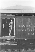 #62 ? Baggage car.  Door open. R.R. man withcoffer cup standing in open doorway.<br /> D&amp;RGW