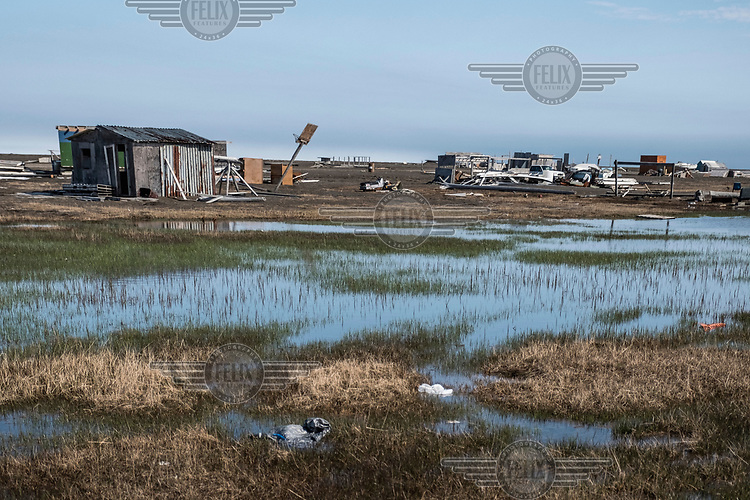 A flooded area of land around a hunting camp near Point Barrow.