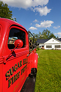 Sugar Hill Lupine Festival - Red fire engine at the Sugar Hill historical society in Sugar Hill, New Hampshire USA during the summer  months
