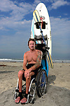 ENCINITAS, CA - MARCH 7: Paraplegic surfer and athlete Jeremy McGhee poses for a portrait at Cardiff Reef on July 3, 2013 in Encinitas, California. McGhee lost use of all his muscles and feeling below his sternum after a motorcycle crash several years ago, but continues to live an adventurous lifestyle of surfing, skiing, swimming and paddling while also giving motivational public speeches. A local shaper Jeff Grygera made him a special board in which Jeremy's legs and lower bag are strapped in and supported, while he to paddles into waves with a kayak paddle and disengages from board and swim with his arms if he flips.