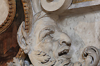 Head of a laughing satyr in carved stucco from the frame of the fresco Filial Piety by Rosso Fiorentino, 1535-37, in the Galerie Francois I, begun 1528, the first great gallery in France and the origination of the Renaissance style in France, Chateau de Fontainebleau, France. The Palace of Fontainebleau is one of the largest French royal palaces and was begun in the early 16th century for Francois I. It was listed as a UNESCO World Heritage Site in 1981. Picture by Manuel Cohen