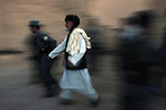 An elderly man is taken into custody at dusk by Afghan police during a sting targeting a suspected Taliban informant in the village of Gul Muhammed in Zabul province, Afghanistan. The man was later released. Aug. 26, 2008. DREW BROWN/STARS AND STRIPES