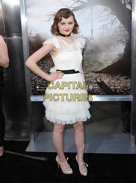 Joey King<br /> &quot;The Conjuring&quot; Los Angeles Premiere held at the Cinerama Dome, Hollywood, California, USA.<br /> July 15th, 2013<br /> full length white lace dress sheer layered layers tiered black belt choker hand on hip<br /> CAP/DVS<br /> &copy;DVS/Capital Pictures