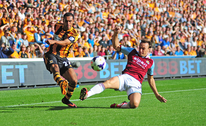 Hull City's Ahmed Elmohamady gets a cross in despite the attentions of West Ham United's Mark Noble <br /> <br /> Photo by Chris Vaughan/CameraSport<br /> <br /> Football - Barclays Premiership - Hull City v West Ham United - Saturday 28th September 2013 - Kingston Communications Stadium - Hull<br /> <br /> &copy; CameraSport - 43 Linden Ave. Countesthorpe. Leicester. England. LE8 5PG - Tel: +44 (0) 116 277 4147 - admin@camerasport.com - www.camerasport.com