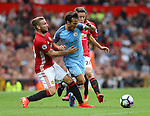 David Silva of Manchester City tackled by Luke Shaw of Manchester United during the Premier League match at Old Trafford Stadium, Manchester. Picture date: September 10th, 2016. Pic Simon Bellis/Sportimage