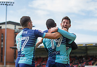 Joe Jacobson of Wycombe Wanderers celebrates with goalscorer Myles Weston (19) of Wycombe Wanderers during the Sky Bet League 2 match between Leyton Orient and Wycombe Wanderers at the Matchroom Stadium, London, England on 1 April 2017. Photo by Andy Rowland.