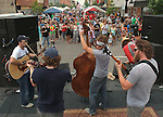 "The local band Old Salt Union has the crowd on tapping their feet to the beat as they cranked out slam-bluegrass music (also known as ""new"" bluegrass) at the first Belleville Brew & Que in downtown Belleville.  This first-ever event featured a Barbecue Challenge and craft beer tasting at 20 downtown businesses. Three bands played during the event, which ran from 11 a.m. to 9 p.m.  The Craft Beer Walk ran from noon to 4 p.m. at select downtown Belleville merchants.  For a $15 ticket, you could have 16 tastings of a wide variety of craft beers.  The Barbecue Challenge ran all day, with vendors selling samples of two meats for $1, or a meaty rib bone for $2."