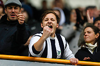 9th February 2020; The Den, London, England; English Championship Football, Millwall versus West Bromwich Albion; West Bromwich Albion fan celebrates towards the camera from the away stands after the final whistle as West Bromwich Albion are top of the 2020/21 Championship