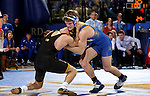 BROOKINGS, SD - DECEMBER 2:   Ben Gillette from SDSU controls Thomas Gilman from Iowa in their 125 pound match Friday night at Frost Arena in Brookings, SD.(Photo by Dave Eggen/Inertia)