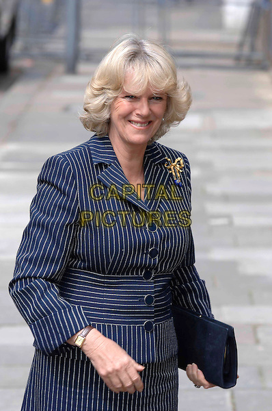 CAMILLA DUCHESS OF CORNWALL.Arrives at the Institute for Indian Art and Culture, Bharatiya Vidya Bhavan, 4a Castletown Road, London, W14, April 29th 2005..half length Parker Bowles navy blue pinstripe suit jacket pin stripe clutch bag gold brooch broach royal.Ref: PL.www.capitalpictures.com.sales@capitalpictures.com.©Capital Pictures