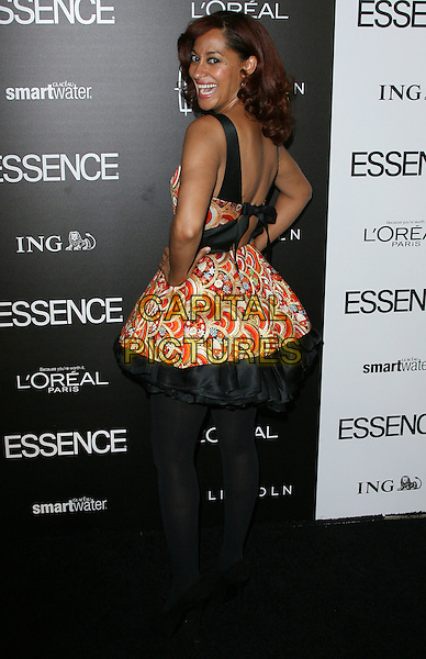 Tracee Ellis Ross.5th Annual ESSENCE Black Women In Hollywood Luncheon held at the Beverly Hills Hotel, Beverly Hills, California, USA..February 23rd, 2012.full length black tights dress tulle orange red dress hands on hips looking over shoulder.CAP/ADM.©AdMedia/Capital Pictures.