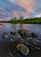 The Wisconsin River flows at sunset through Council Grounds State Park in Merrill, Wisconsin
