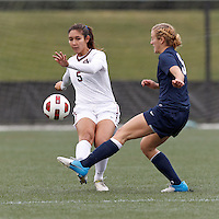 Harvard University midfielder Aisha Price (5) clears the ball as Yale University midfielder Kristen Forster (5) pressures. In overtime, Harvard University defeated Yale University,1-0, at Soldiers Field Soccer Stadium, on September 29, 2012.