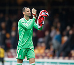 Joe Lewis applauds the Aberdeen fans