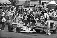 Bobby Rahal walks towards his car at the end of the pit lane after a fire started following a pit stop in the 1982 IndyCar race at Phoenix International Raceway near Phoenix, Arizona.