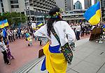 Julia Kosivchuk, of San Francisco, listens to speakers at the Ukrainian rally in Justin Herman Plaza, in San Francisco, California, on Sunday, March 9th, 2014.  Photo/Victoria Sheridan