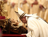 Pope Francis kisses a statue of Baby Jesus as he celebrates the Christmas Eve Mass in St. Peter's Basilica at the Vatican, on December 24, 2018.<br /> UPDATE IMAGES PRESS/Isabella Bonotto<br /> <br /> STRICTLY ONLY FOR EDITORIAL USE