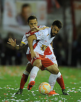 BUENOS AIRES - ARGENTINA - 02-12-2015: Jose San Roman  (Der.) jugador de Huracan de Argentina de disputa el balon con Luis Seijas (Izq.) jugador de Independiente Santa Fe de Colombia durante partido de ida por la Final, de la Copa Suramericana entre Huracan de Argentina y el Independiente Santa Fe de Colombia en el estadio Tomas A Duco, de la ciudad de Buenos Aires.  / Jose San Roman (R) player of Huracan of Argentina vies for the ball con Luis Seijas (L) player of Independiente Santa Fe of Colombia during a match for the first leg for the final, between Huracan of Argentina and Independiente Santa Fe of Colombia for the Copa Suramericana in the Tomas A Duco stadium, in Buenos Aires city. Photo: Ignacio Izaguirre / Photogamma / VizzorImage.